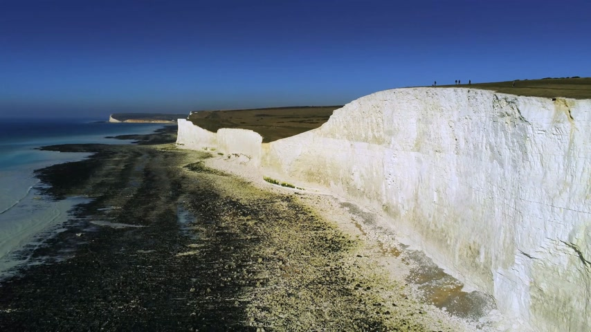 head over : Flight over the white cliffs of Beachy Head and Seven Sisters in England