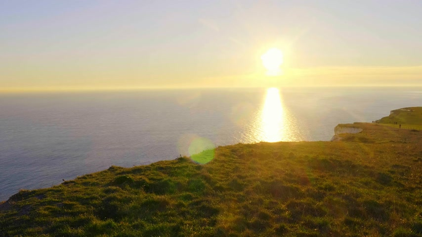 erodida : Sunset over the White Cliffs at Beachy Head in Sussex England Stock Footage