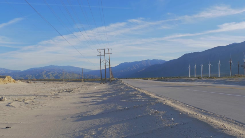 molas : Street in the desert leading to Palm Springs California Stock Footage