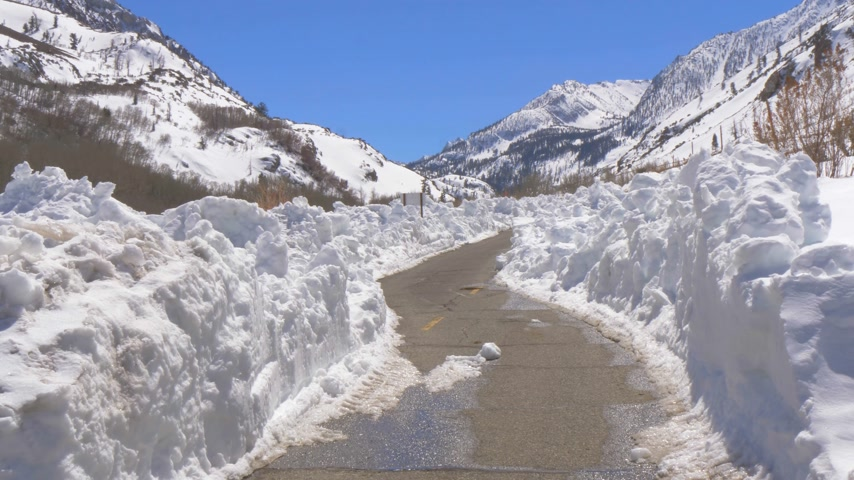 eastern sierra : Scenic road through the snowy mountains of Sierra Nevada Stock Footage