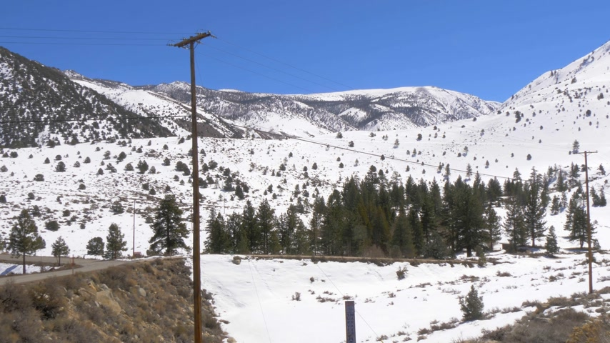 eastern sierra : Sierra Nevada with it snowy mountains on a winters day Stock Footage