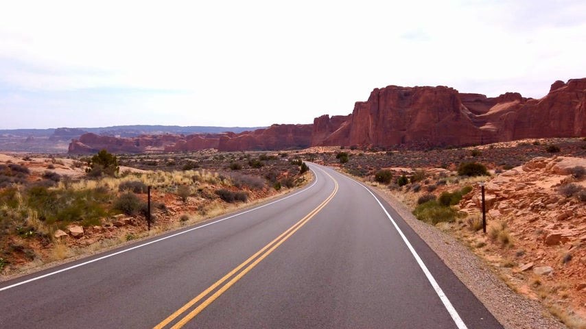 pináculo : Driving through Arches National Park - travel photography Vídeos