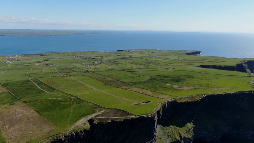 kelta : Aerial view over the famous Cliffs of Moher in Ireland Stock mozgókép