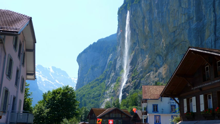 gigante : Giant waterfall in the Swiss Alps - SWISS ALPS, SWITZERLAND - JULY 20, 2019