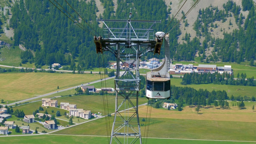 picturesque view : Teleferic Ropeway at Corvatsch mountains in Engadin Switzerland - SWISS ALPS, SWITZERLAND - JULY 20, 2019