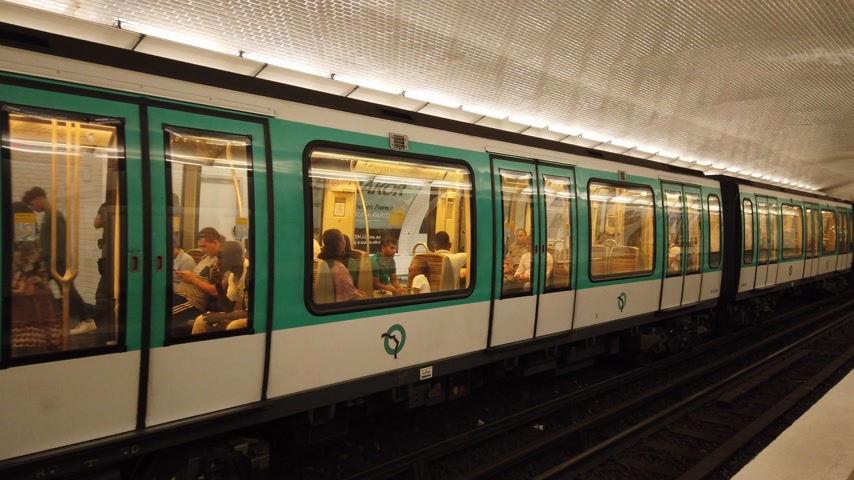 french metro : Subway station in Paris - Paris Metro public transport - PARIS, FRANCE - JULY 29, 2019 Stock Footage