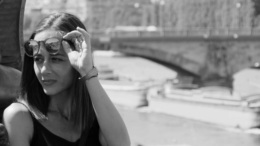 eiffel : French girl enjoys a sunny day at River Seine in Paris