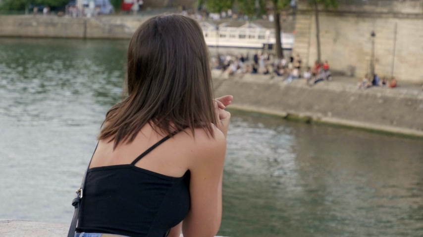 parisian : Young French woman relaxes at River Seine in Paris
