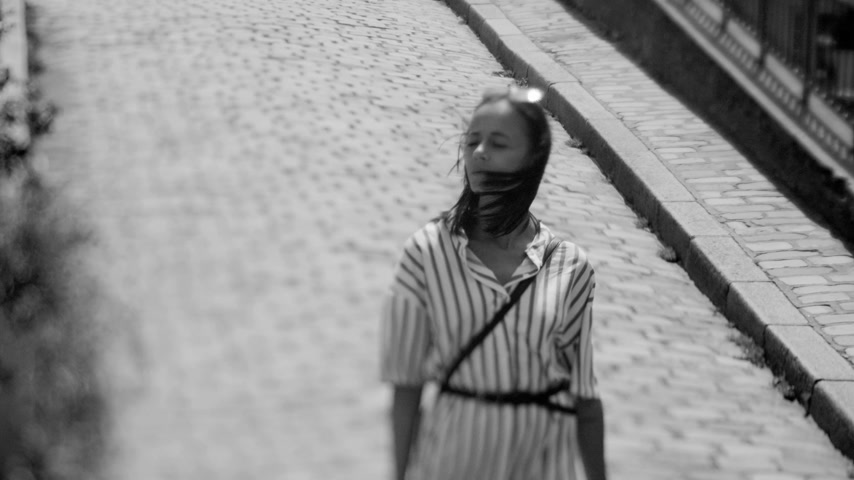 eiffel : Beautiful girl walks through the streets on a summer day in Paris Stock Footage