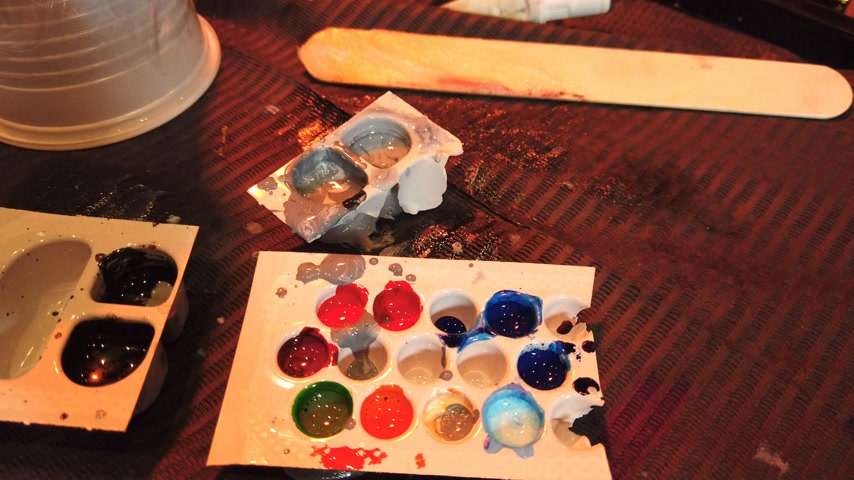 delici : Ink palette at a tattoo studio - tattooer at work