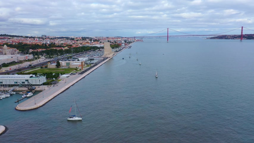 belem : River Tejo also called Tagus river in Lisbon with famous 25th April Bridge Stock Footage