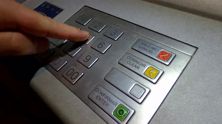 externo : Entering a pin code at ATM cash machine Vídeos