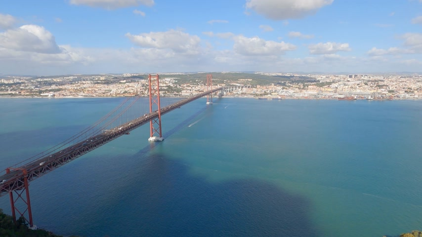 подвесной : Aerial view over 25th of April Bridge in Lisbon also called Salazar Bridge Стоковые видеозаписи