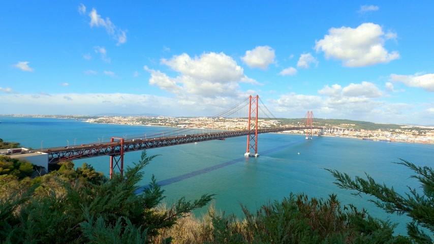 nisan : Aerial view over 25th of April Bridge in Lisbon also called Salazar Bridge Stok Video