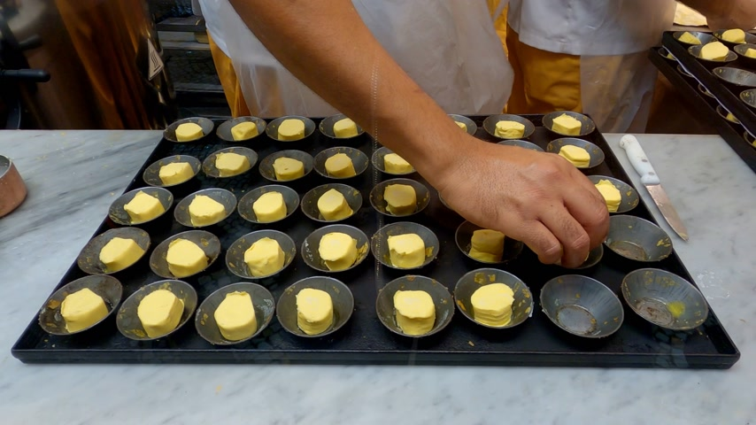 elegant dessert : Bakery in Lisbon making the famous cream tarts called Pasteis de Nata