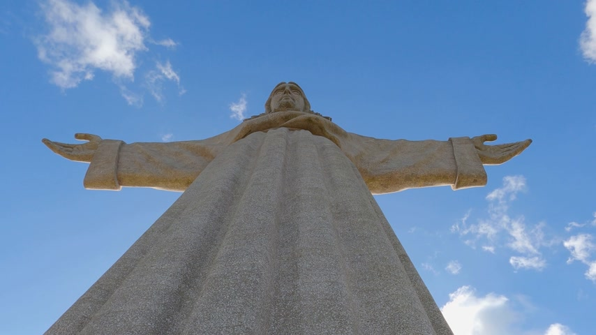 salvezza : Christ statue on the hill of Lisbon Almada called Cristo Rei