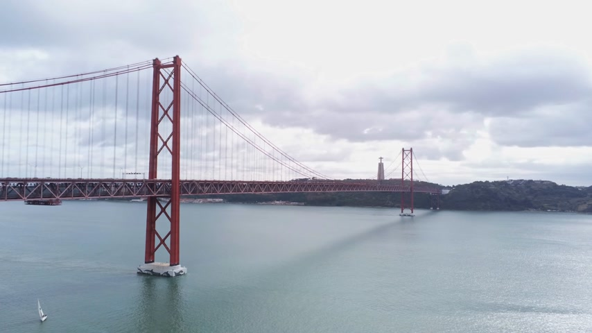 the suspension bridge : Lisbon sightseeing from above - famous 25th of April Bridge Stock Footage