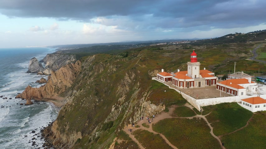 синий : Portugal from above - Cabo da Roca with its famous lighthouse Стоковые видеозаписи