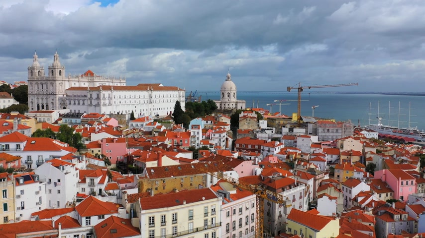 alfama : Aerial view over the historic Alfama district of Lisbon Stock Footage