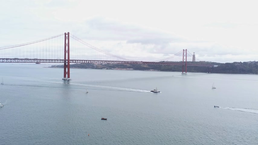 the suspension bridge : Aerial view over famous 25th of April Bridge at River Tejo in Lisbon