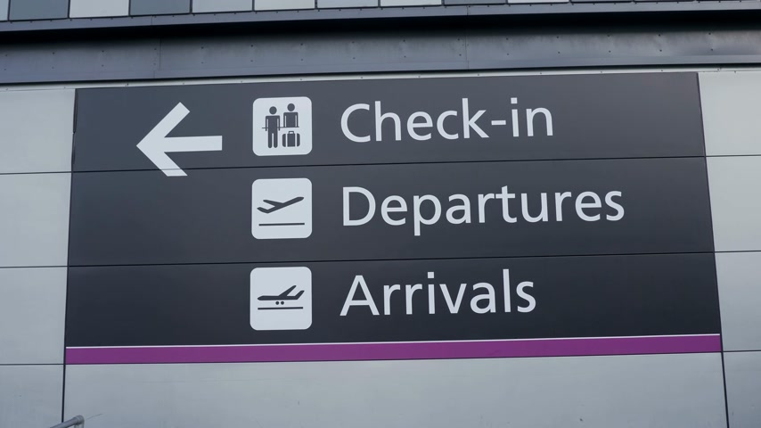 built structure : Check in - Departures - Arrivals Sign at the airport - EDINBURGH, SCOTLAND - JANUARY 10, 2020 Stock Footage
