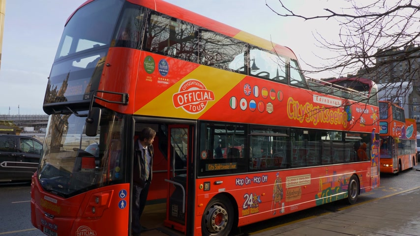 great britain : City sightseeing bus in Edinburgh - EDINBURGH, SCOTLAND - JANUARY 10, 2020