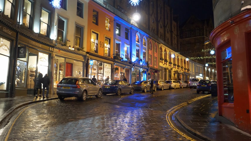 Colorful West Bow Street in Old town of Edinburgh by night - EDINBURGH, SCOTLAND - JANUARY 10, 2020