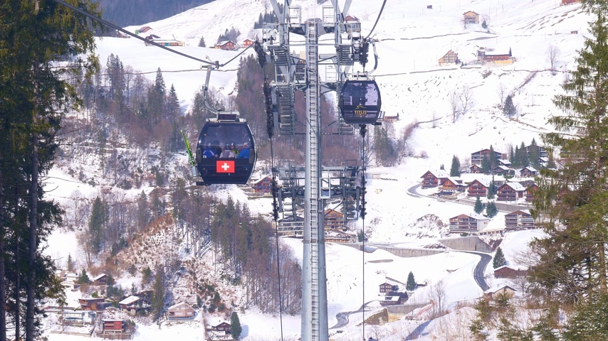 Ride in a cable car in the Alps on a winters day - ENGELBERG, SWISS ALPS - FEBRUARY 5. 2020