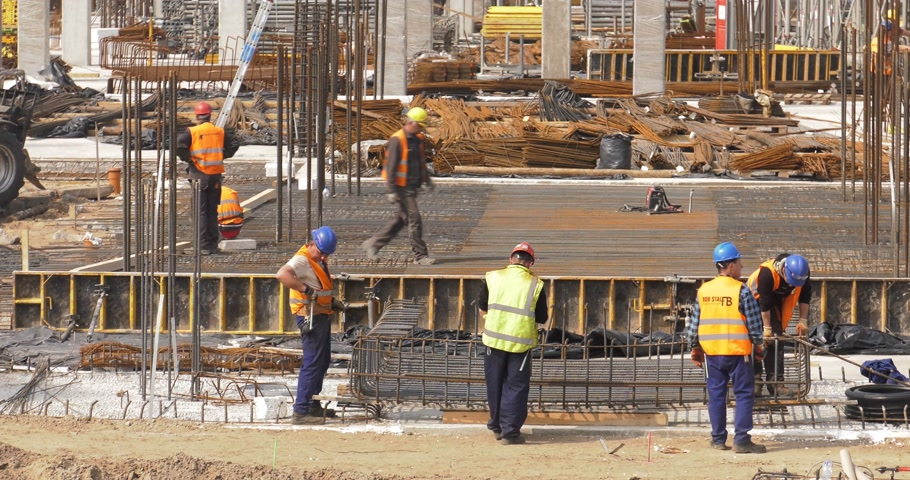 katowice : Poland, Katowice, April 2017:     Huge construction site. Workers are working on the foundations of the building. Fix the steel bars. Prepare soil for flooding with concrete.    Closeup