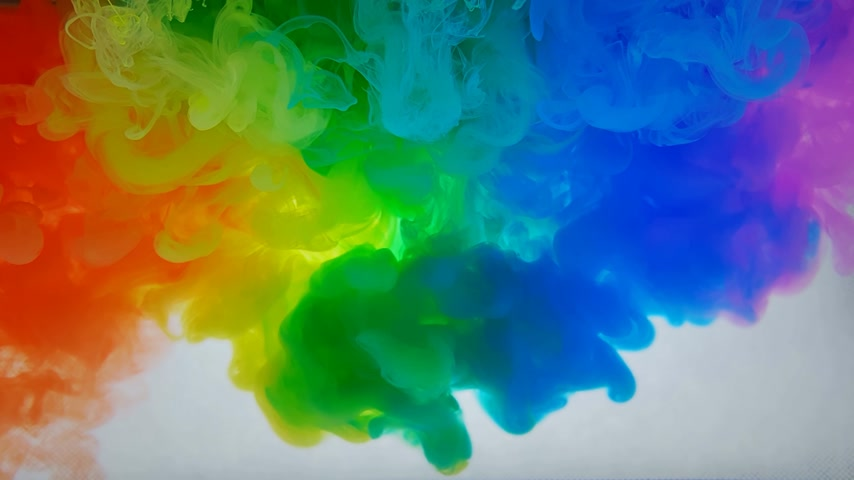 whirling : 4k. A beautiful mixture of acrylic ink in water. Ink streams of rainbow colors form abstract clouds when mixed. Acrylic clouds on a white background. Slow motion Stock Footage