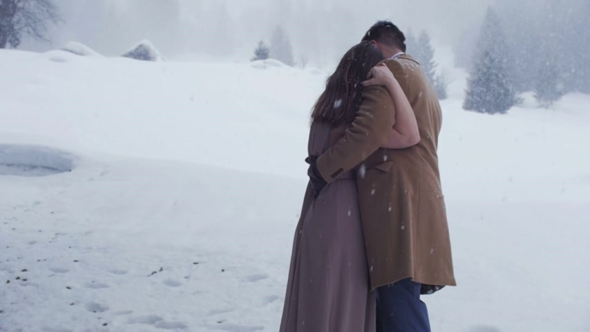 Couple Hugging in the Snow