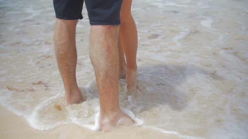 Couple Legs on the Ocean Shore
