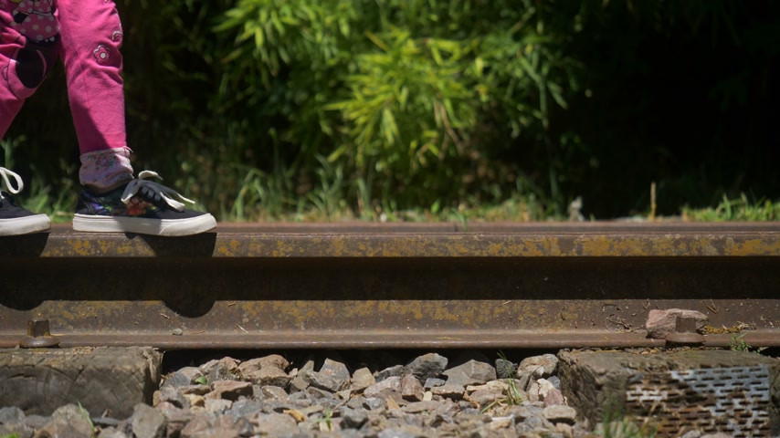 Little Girl Walking on Train Rails Wideo