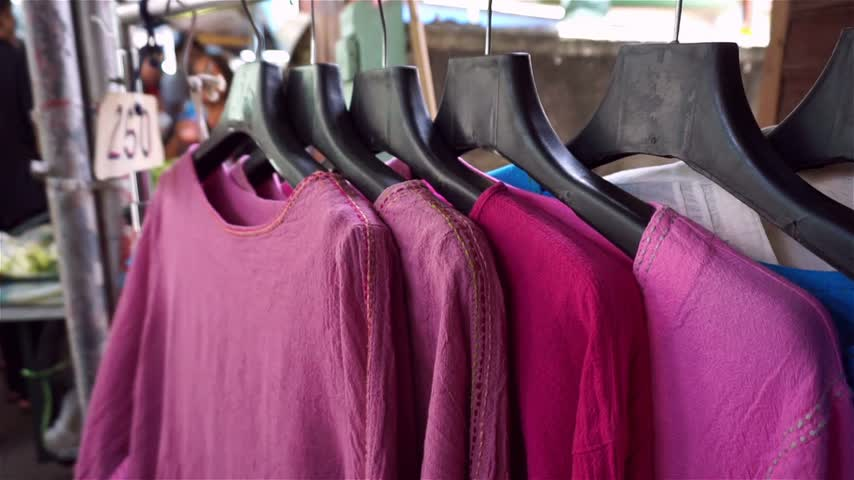 Clothes shop at market in Thailand Stock Footage