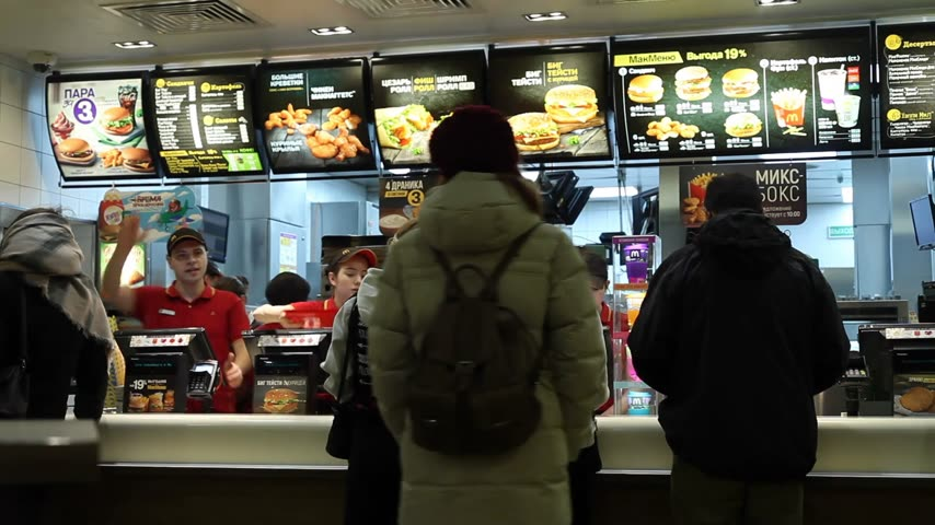 franczyza : Minsk, Belarus, January 8, 2018: People order food in a McDonalds Restaurant Wideo