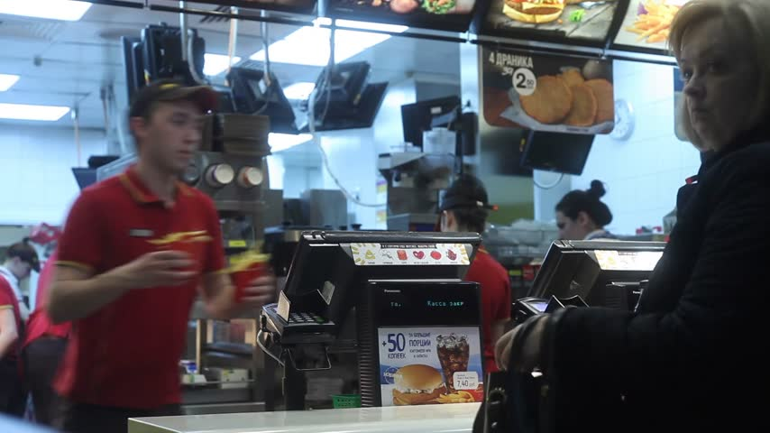 franczyza : Minsk, Belarus, April 14, 2018: Visitor order food in Mcdonalds Restaurant