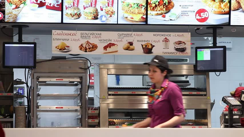 franczyza : Minsk, Belarus, May 6, 2018: Restaurant worker collects an order and customer receives order in KFC Restaurant. Wideo