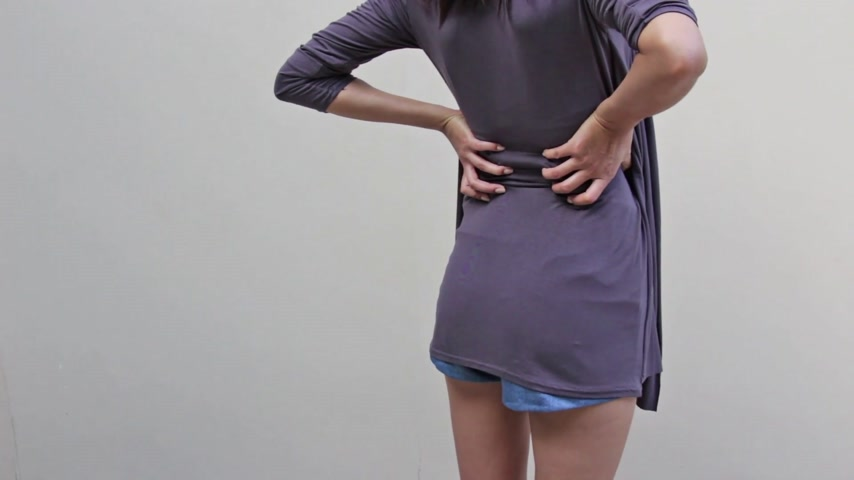 çıkıntı : woman with backpain, spinal, waist, lower back problem, quarter view from rear