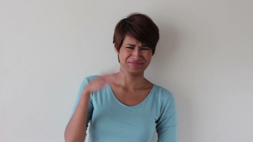 smell : woman pinching her nose reacting to bad smell Stock Footage