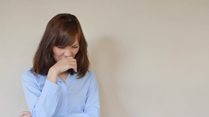 unpleasant smell : woman smelling bad smell, covering her nose