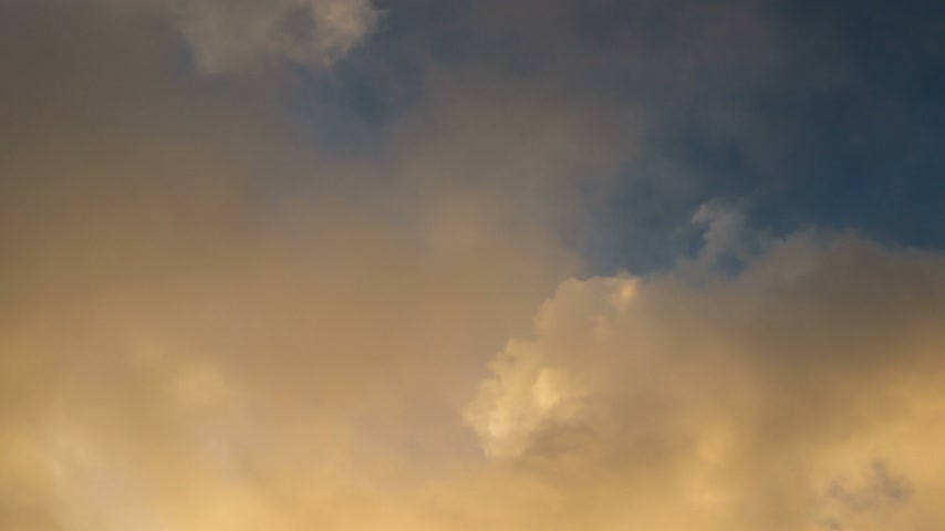god ray : beautiful orange clouds running over blue sky. Stock Footage