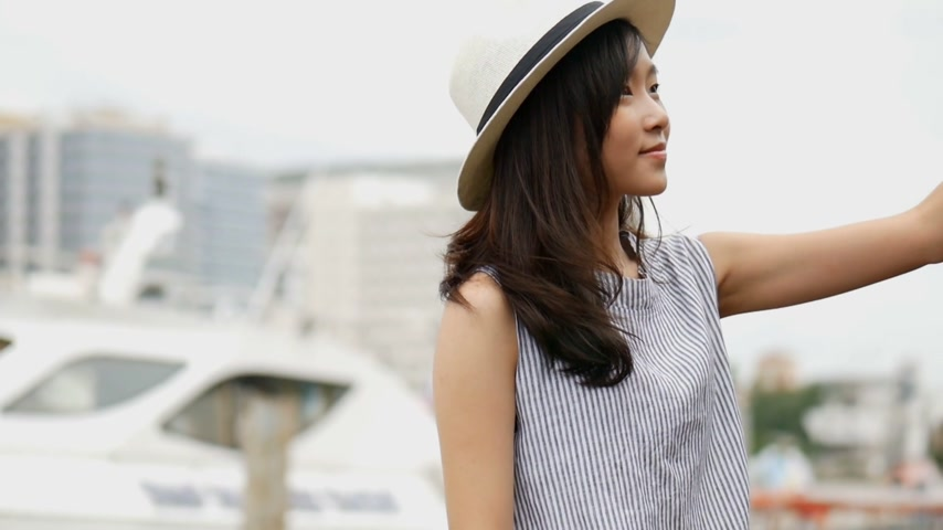 phraya : Beautiful asian woman taking selfies on a smartphone. Young asian girl smiling happy travel.
