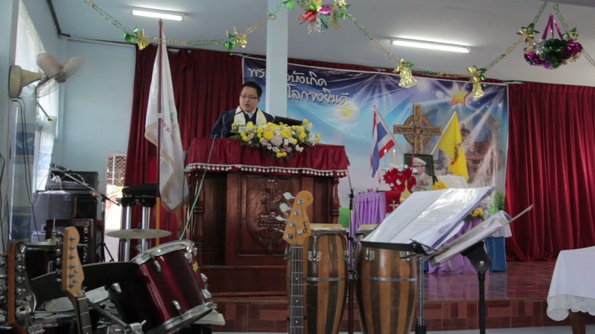 communion : CHIANGRAI, THAILAND - DECEMBER 7: Unidentified man in front of the church making ritual in christian church on December 7, 2014 in Chiangrai, Thailand.
