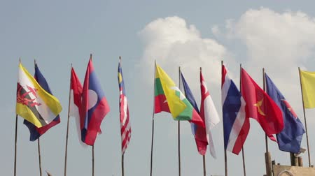 blue flag : national flags of Southeast asia countries  ASEAN  waving atop, blue sky background Stock Footage
