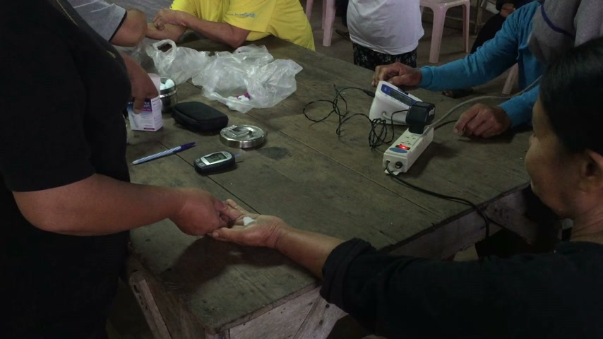 self examination : CHIANG RAI, THAILAND - OCTOBER 31 : unidentified asian people taking blood test to find out diabetes with home glucometer on October 31, 2016 in Chiang rai, Thailand.