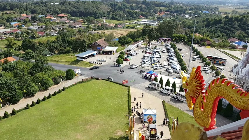 kang : CHIANG RAI, THAILAND - DECEMBER 3 : time lapse Unidentified tourists visit Wat Hyua Pla Kang (Chinese temple) on December 3, 2016 in Chiang rai, Thailand. view from highest level of the pagoda.