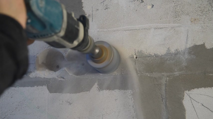 fasteners : Drilling holes in the foam concrete for setting rings for sockets Stock Footage