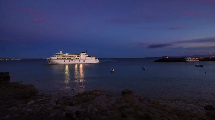 multa : Large Armas ferry carrying cars and passengers arriving in the evening in the port of Playa Blanca in Lanzarote, Spain