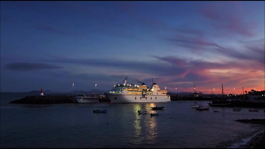 Large Armas ferry carrying cars and passengers arriving in the evening in the port of Playa Blanca in Lanzarote, Spain