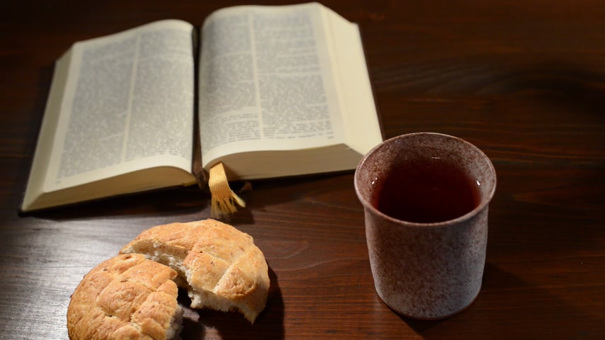 biblia : bible with chalice and bread, panning,sliding